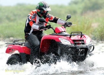 atv rider in water