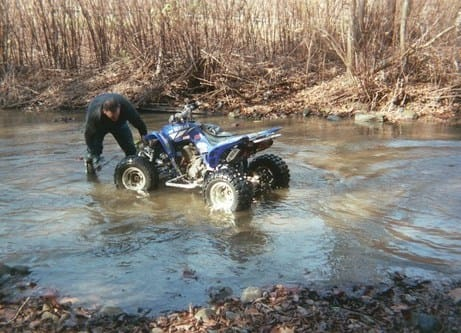atv in the water